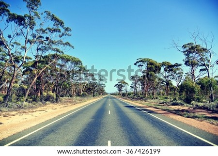 Long straight road in Australia - stock photo