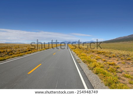 Long straight road in southern Colorado - stock photo