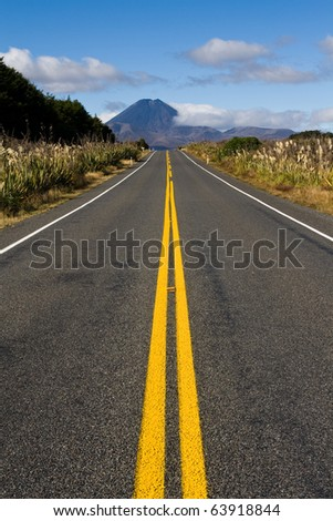 Long straight road to mt doom mountain, new zealand - stock photo