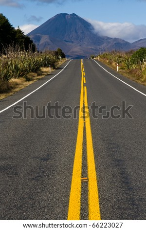 Long straight road to mt doom volcano mountain background, new zealand - stock photo
