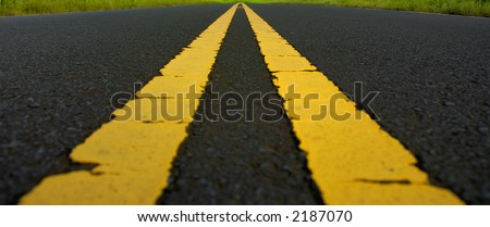 long stretch of highway with double yellow line - stock photo