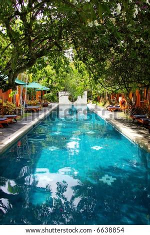 long swimming pool on balinese spa resort - stock photo