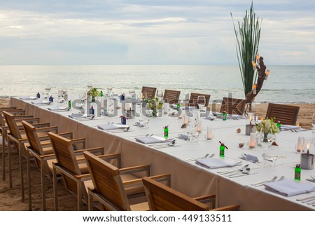 Long table wedding dinner setup on the beach at  Thailand