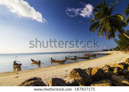 Long-tail boat and beautiful beaches in Thailand - stock photo