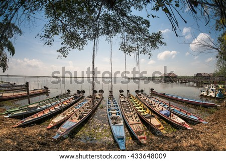 Long-tail boat, floating in water of fisherman and boats. Thalanoi national park in Phatthalung, Thailand. Beauty world. - stock photo