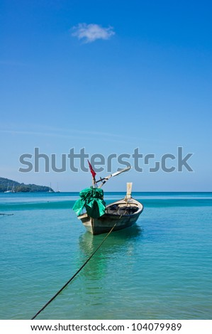 Long tail boat in the ocean with blue sky. - stock photo