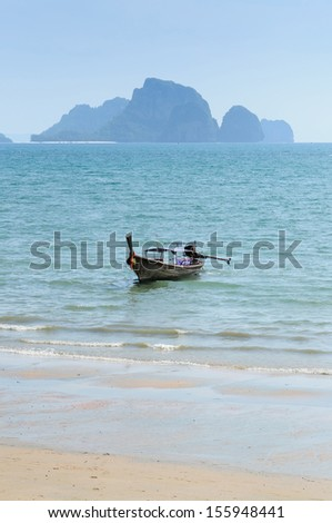Long Tail boat on the beach in Krabi Thailand