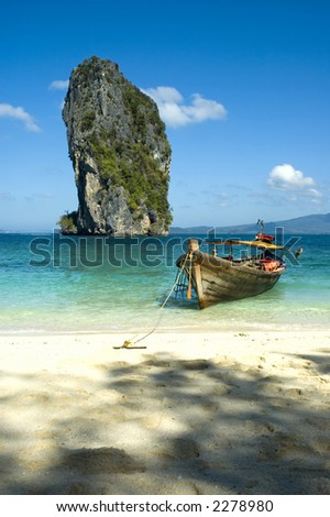 long tail boat on the beach in thailand
