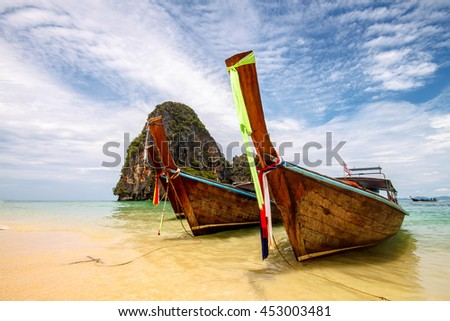Long tail boat on the white sand beach of Railay Beach, Krabi Th - stock photo