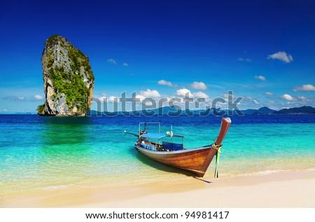 Long tail boat, Tropical beach, Andaman Sea, Thailand - stock photo