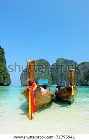 Long-tail boats at Maya bay of Phi-Phi island, Krabi, Thailand - stock photo