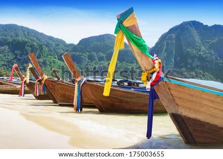 Long tail boats at the beach, Thailand - stock photo