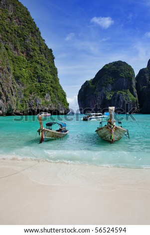 Long tail boats in Maya Bay, Koh Phi Phi Ley, Thailand. The place where the movie the Beach was filmed. - stock photo