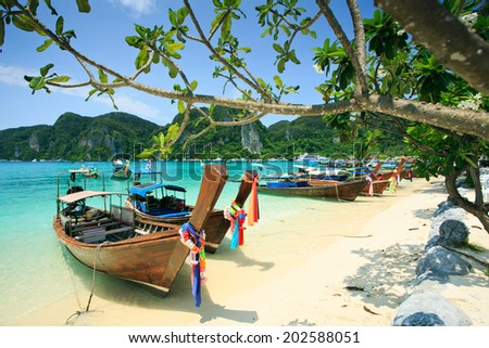 Long tail boats in Phi Phi Island, Krabi, Thailand. - stock photo
