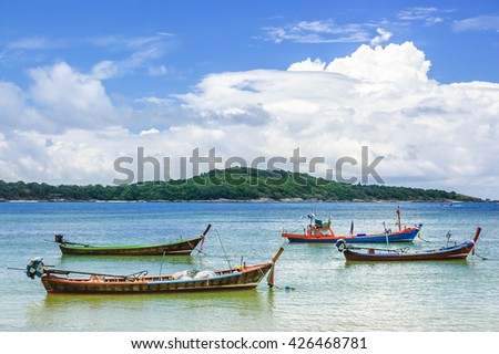 Long-tail boats in Phuket, southern Thailand - stock photo