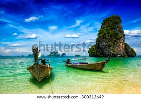 Long tail boats on tropical beach (Pranang beach), Krabi, Thailand - stock photo