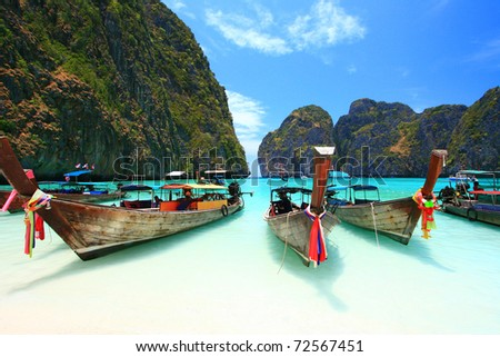 Long Tail Boats parking at the white and beach - stock photo