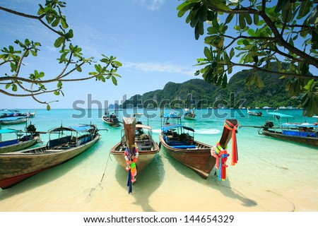 Long tail boats under blue sky in Krabi, Thailand - stock photo