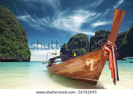 Long-tail Taxi boat on the beautiful ocean beach - stock photo