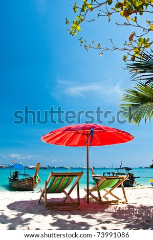Long tailed boat and Beach chair  at Phiphi island in Thailand