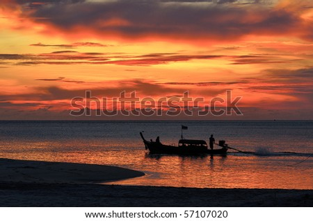 Long-tailed boat and sunset - stock photo