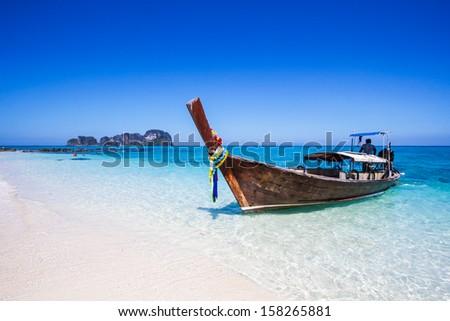 Long-tailed boat at Andaman Sea  Phi Phi island Southeast Asia Thailand  - stock photo