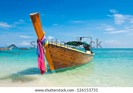 Long tailed boat at Phi-Phi island in Thailand - stock photo