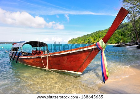 Long Tailed Boat at the beach in southern of Thailand