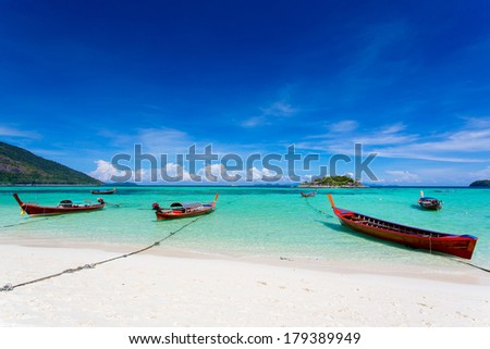 long-tailed boat on Bundhaya beach Koh LIPE Thailand