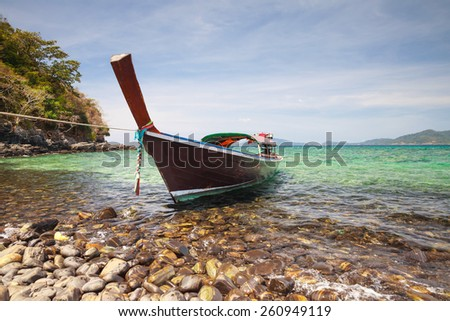 Long-tailed boat on tropical island, Koh Lipe, Andaman sea, Thailand - stock photo