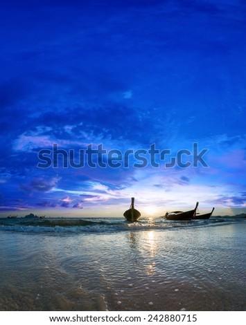 Long tailed boat Ruea Hang Yao in Koh Samui Thailand at sunset - stock photo