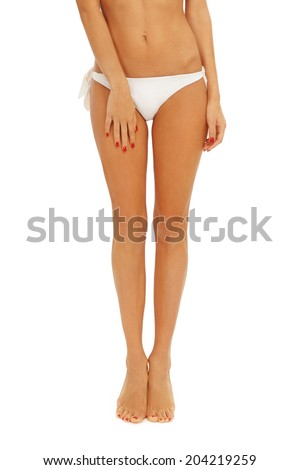 Long tanned legs of young sexy woman in bikini over white background - stock photo