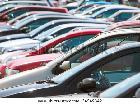 Long telephoto view of cars in parking lot - stock photo