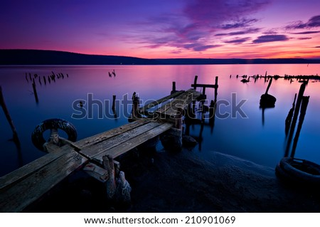 Long time exposure landscape with lake after sunset - stock photo