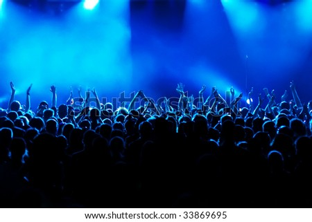 long time exposure/motion blur of cheering crowd at concert - stock photo