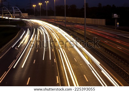 Long time exposure night scene of highway with long car lights trails in Saint-Petersburg, Russia. - stock photo