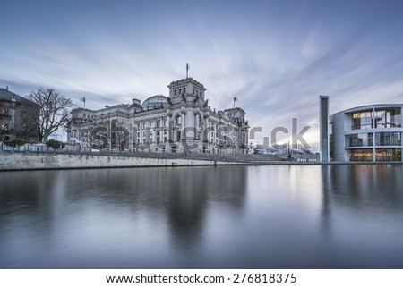 Long time exposure of Reichstag building (seat of German parliament, Bundestag) on river Spree, Berlin Government District, Germany, Europe - stock photo