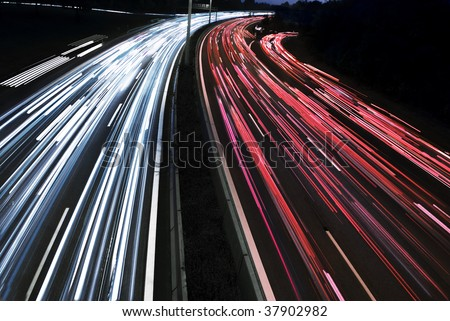 long time exposure of traffic car lights in the motorway - stock photo