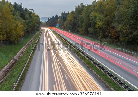 long time exposure over a highway with car light trails - stock photo
