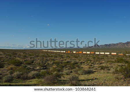 Long train in the desert near South Pass, California - stock photo