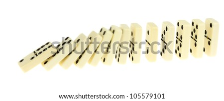 Long train of dominoes falling over, white background - stock photo