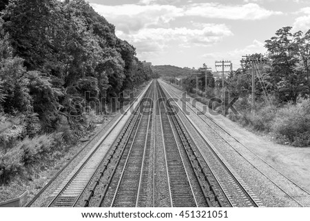 Long train tracks. Industrial design. Industrial background. Vanishing point. Looking outward. Long road ahead. Geometric background. Minimal design. Minimal background. Modern design and background.