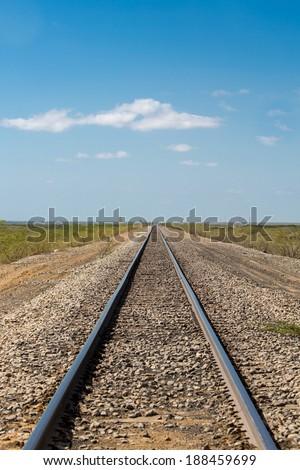Long train tracks to the horizon in Punta Gallinas, La Guajira, Colombia 2014. - stock photo