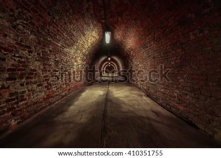 Long underground brick tunnel angle shot - stock photo