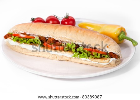 Long vegan sandwich made from integral bred with soya cracklings, soya cheese, lettuce, tofu, serve on plate - stock photo