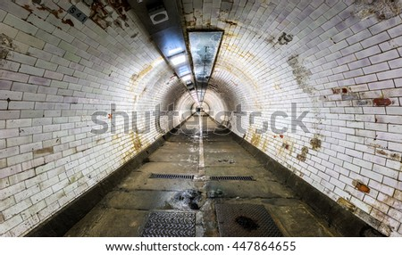 Long vintage tunnel under the river Thames in Greenwich, London - stock photo