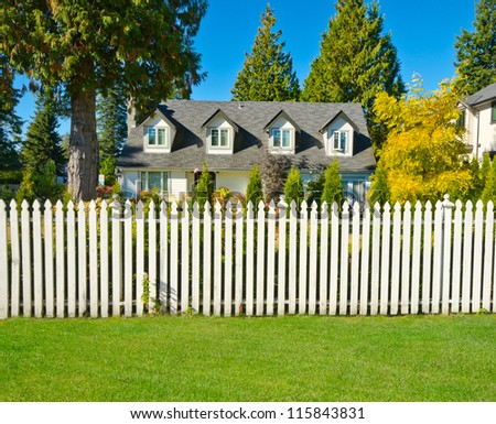 Long white country style wooden fence. - stock photo