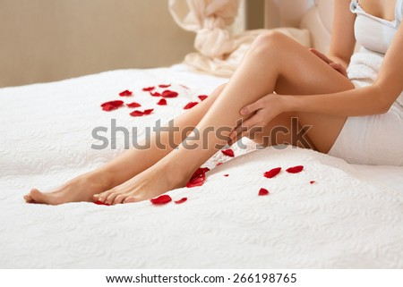 Long Woman Legs. Beautiful Woman Cares About Legs. Depilation - stock photo