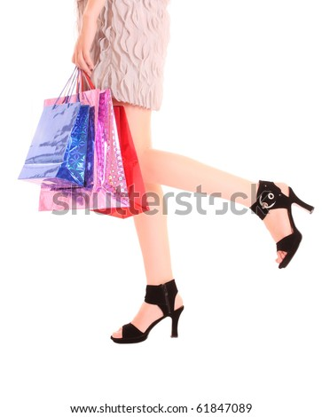 long woman legs in high heels isolated on white - stock photo