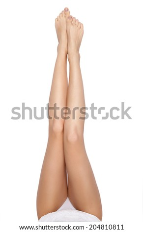 Long woman legs isolated on white. Depilation or another healths concept - stock photo